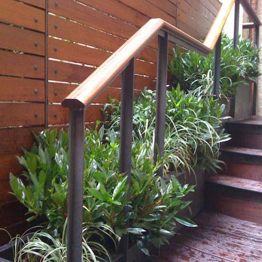 Manhattan townhouse garden backyard terrace deck fence for Terrace stairs