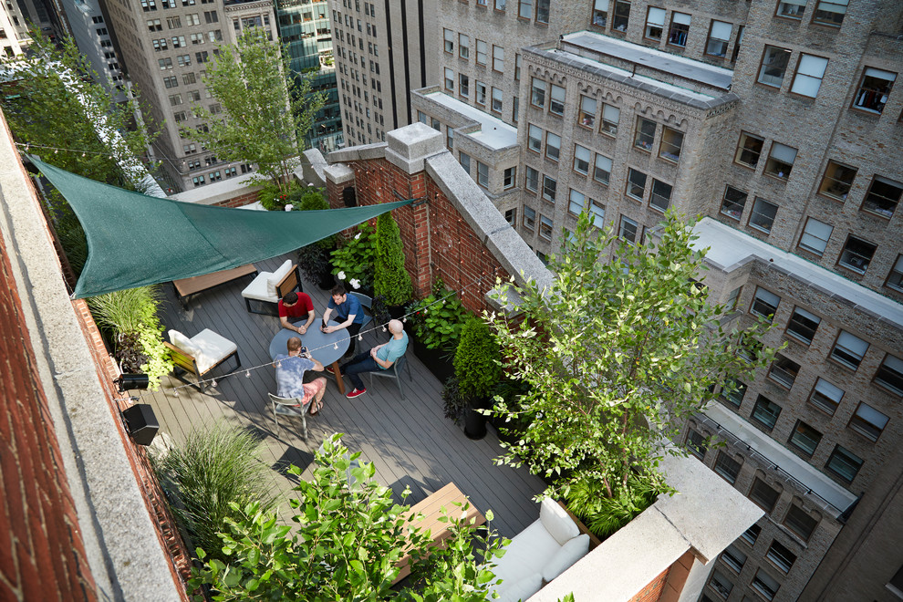 Inspiration for a small timeless rooftop deck container garden remodel in New York with an awning