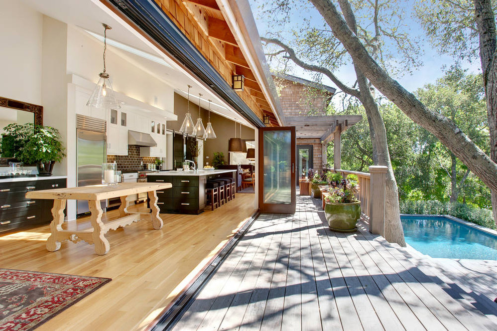 Deck - transitional deck idea in San Francisco with a pergola