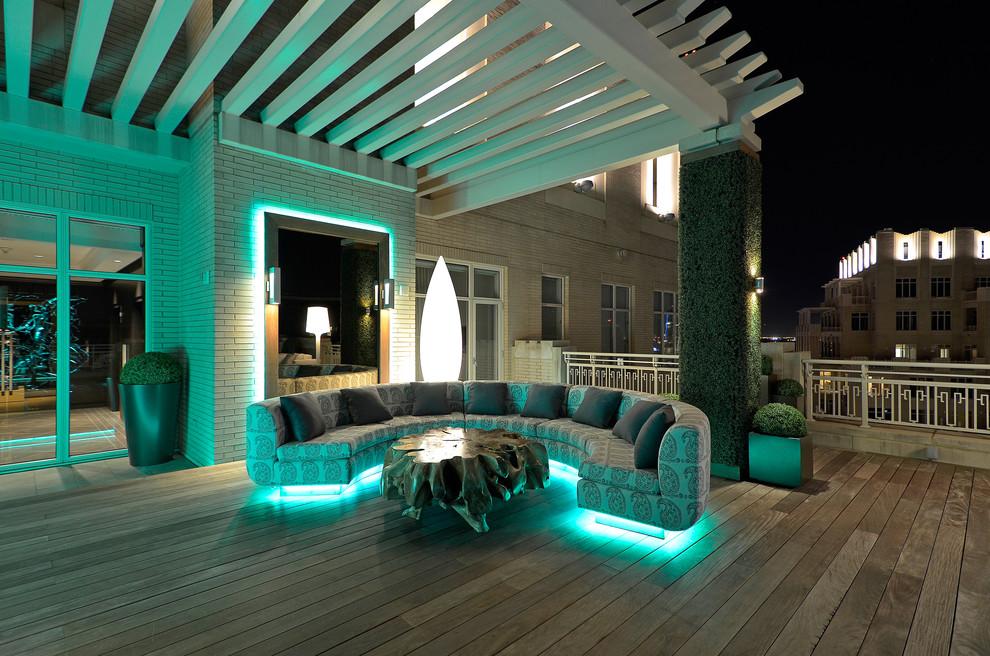 Trendy deck photo in Dallas with a pergola