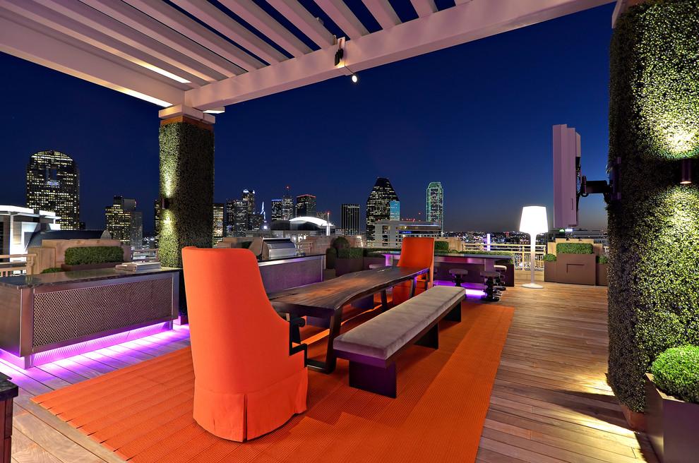 Inspiration for a contemporary deck remodel in Dallas with a pergola