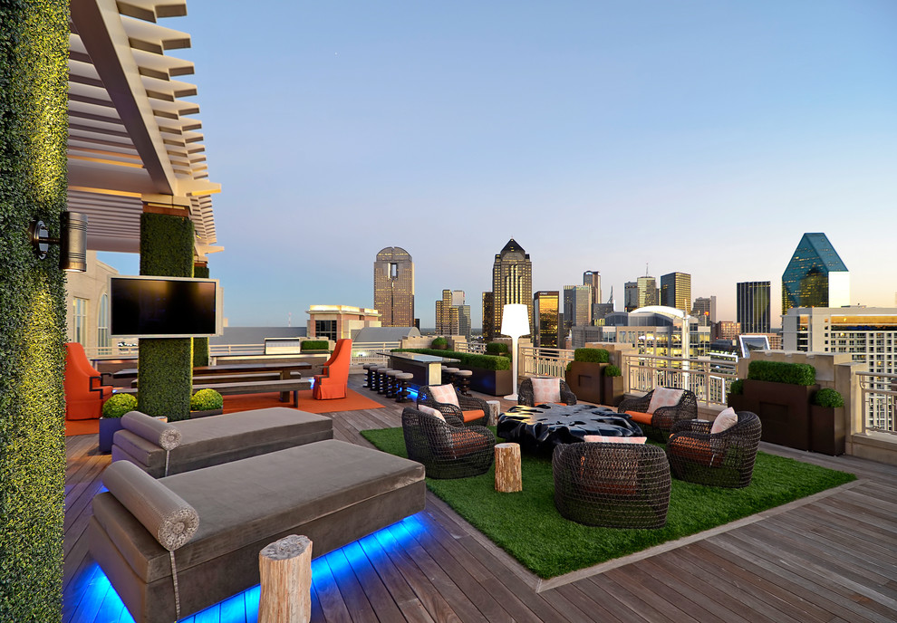 Example of a trendy deck design in Dallas with a fire pit and a pergola