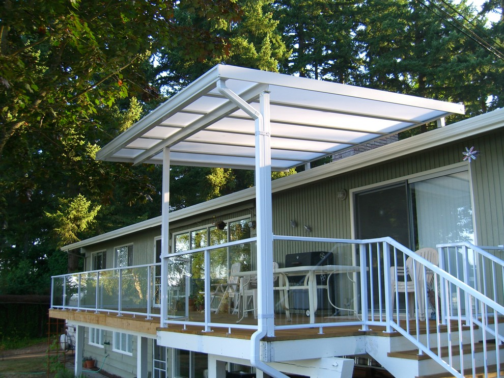 Example of a small classic backyard deck design in Seattle with an awning