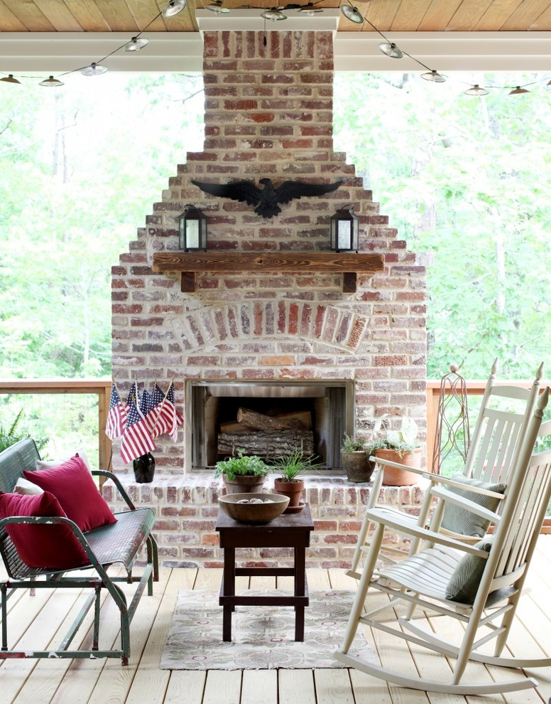 Example of a classic deck design in Little Rock with a fire pit