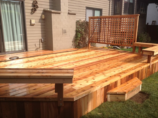 North Delta patio with built in benches and privacy screen. traditional-deck