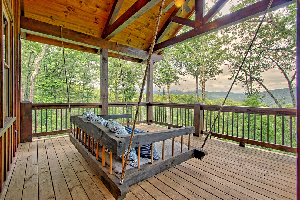 Deck - mid-sized rustic deck idea in Other with a roof extension