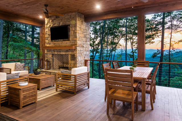 Example of a mountain style deck design in Other with a fire pit