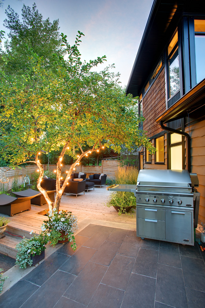 Example of a mid-sized trendy backyard outdoor kitchen deck design in Calgary