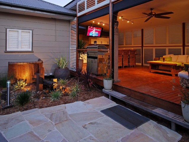 Inspiration For A Tropical Backyard Outdoor Kitchen Deck Remodel In Dallas With Roof Extension