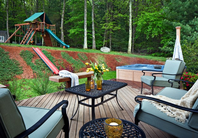 Outdoor living perfection in Belmont, MA with a spacious and elegant cumaru deck traditional-deck