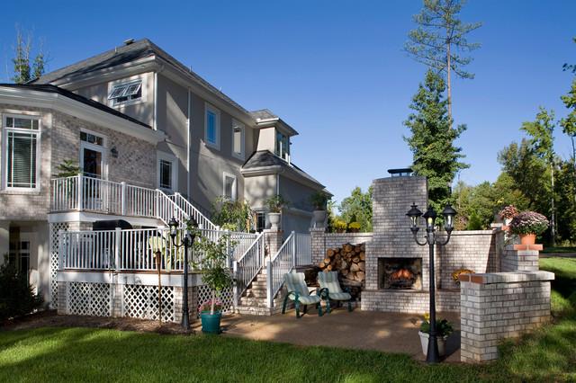Outdoor living space with multi level decks plus patio for Decks plus