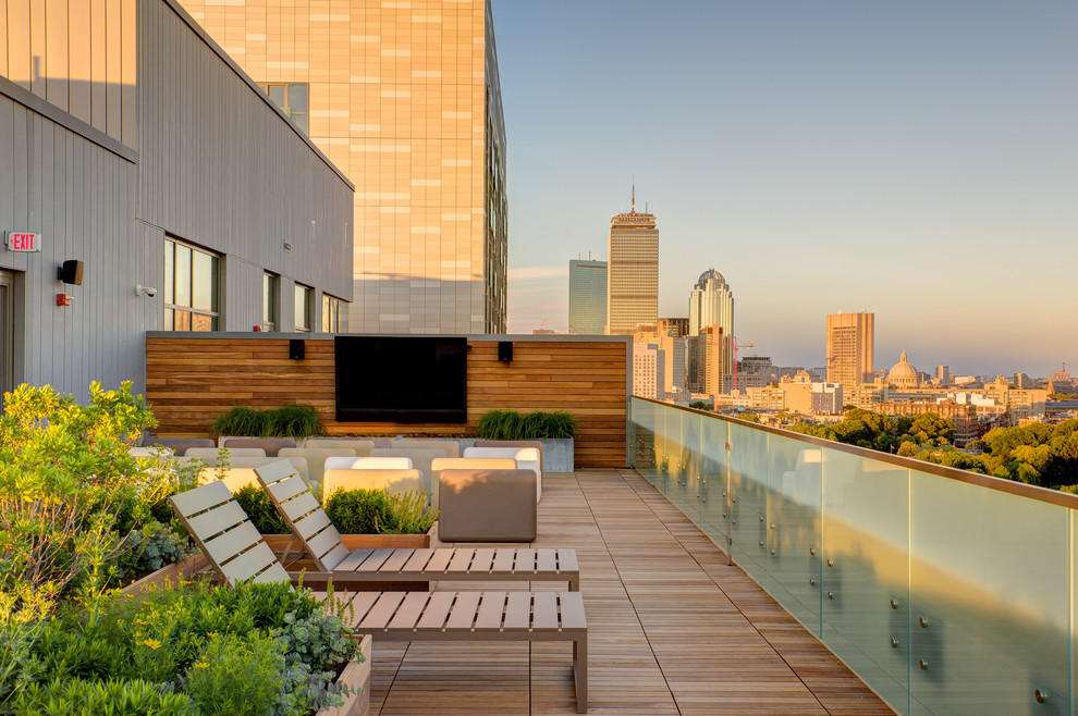 Large trendy rooftop deck container garden photo in Boston with no cover