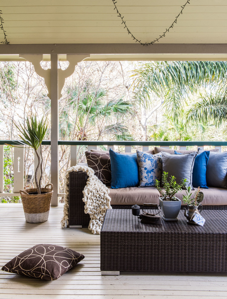 Deck - mid-sized tropical backyard deck idea in Brisbane with a roof extension