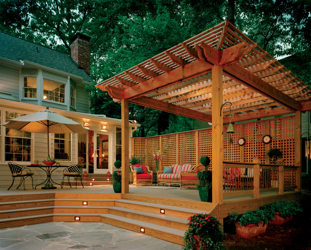 Example of a classic deck design in Atlanta with a pergola