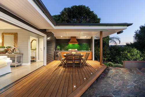 Lovely wooden patio with in floor lighting around the edges.