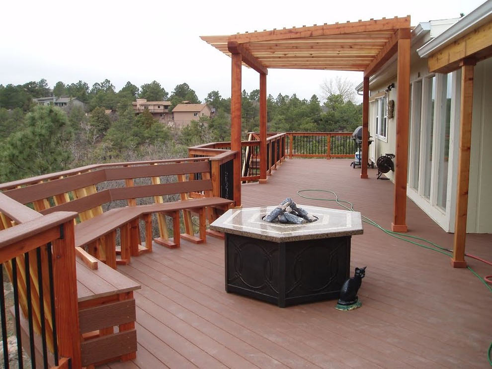 Deck - large traditional backyard deck idea in Denver with a pergola
