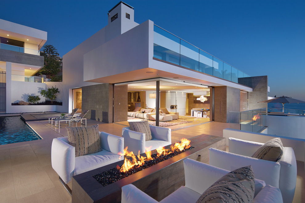 Deck - large contemporary backyard deck idea in Orange County with a fire pit