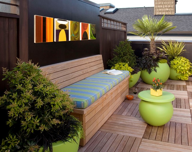 deck with built in bench and cushions with art hung above on the wall