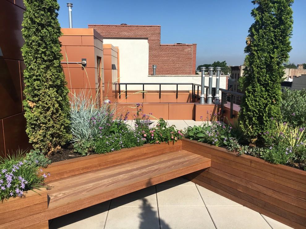 Deck container garden - mid-sized modern deck container garden idea in New York