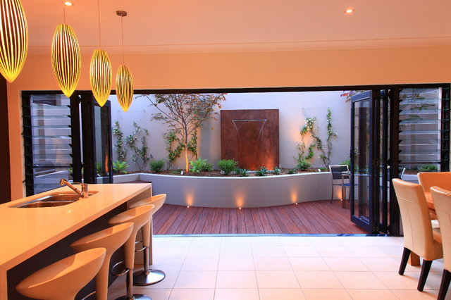 This is an example of a contemporary deck in Sydney with a water feature.