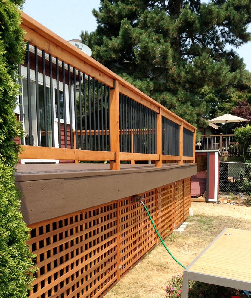 Example of a mid-sized arts and crafts backyard deck design in Seattle with no cover