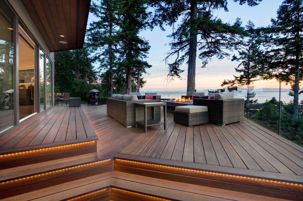 Deck - contemporary deck idea in Vancouver with a fire pit and no cover