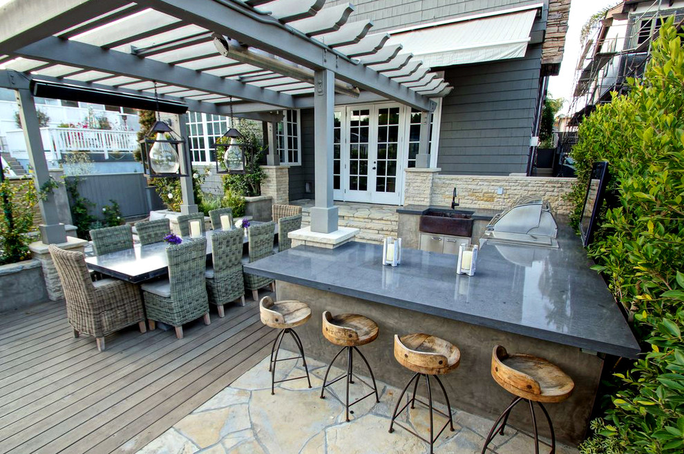 Outdoor kitchen deck - contemporary backyard outdoor kitchen deck idea in Los Angeles with a pergola