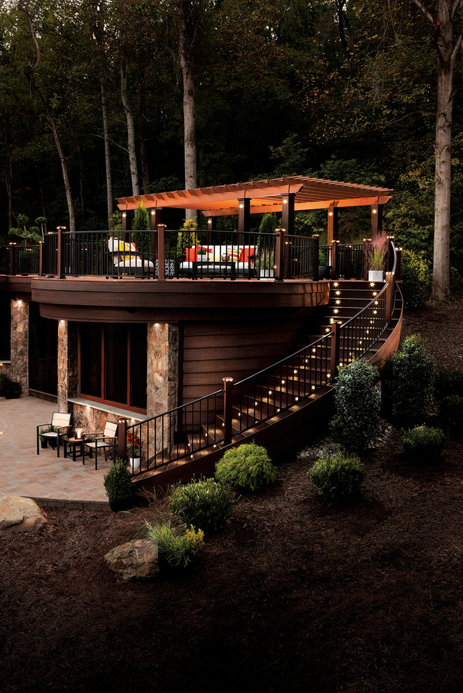 Example of a mountain style rooftop deck design in DC Metro with a pergola