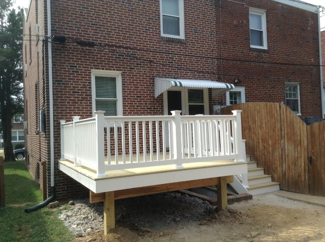 Small 12x12 Deck With Walkway Above Basement Stairs. Deck