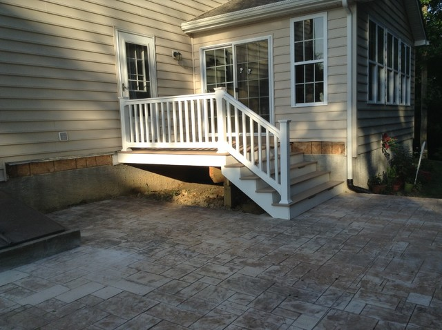 Small 8u0027x8u0027 Deck With Enlarged Stairs Down To Stamped Concrete Patio Modern