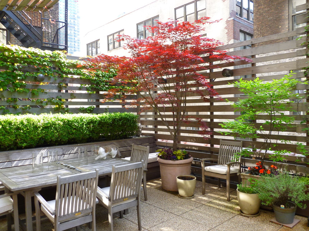 Deck - large modern rooftop deck idea in New York