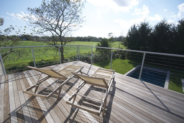The 2nd floor deck offers views of the neighboring farm field. farmhouse-deck