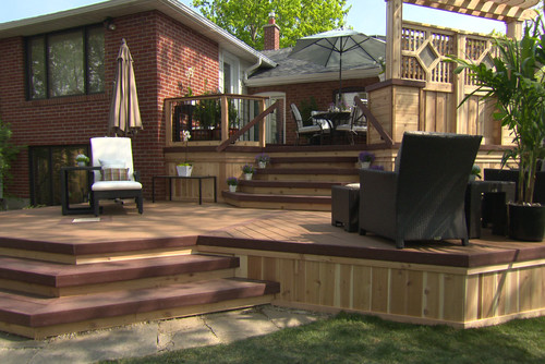 This Lovely Cedar Deck Has Two Distinct Areas: The Top Level Is Walled Off  With