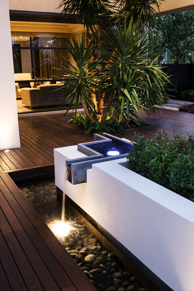Water fountain deck - contemporary water fountain deck idea in Perth with no cover