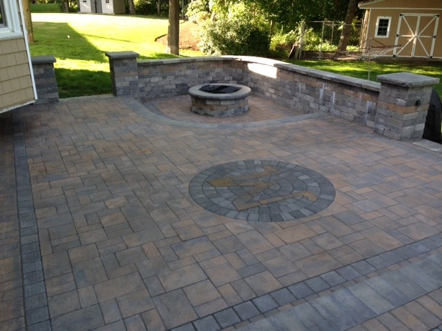 Tiered raised patio kitchen fire pit traditional for Fireplace on raised deck