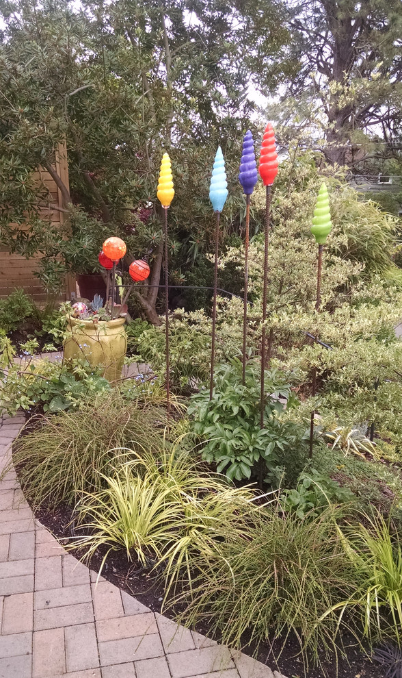 Inspiration for a small eclectic deck remodel in Seattle