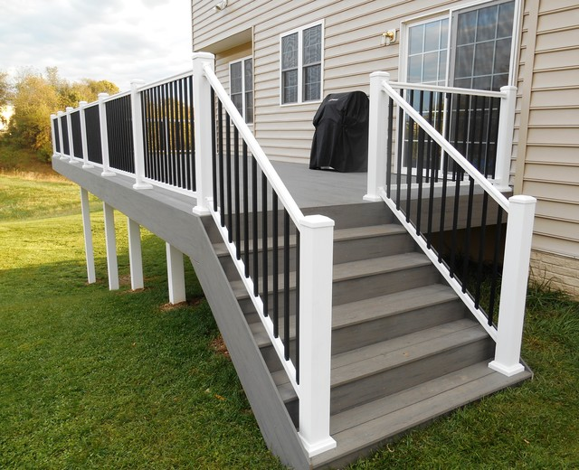 Timbertech deck in silver maple and white vinyl handrail Terrain decking