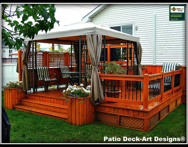 Patio deck art designs outdoor living traditional deck for Backyard deck designs pictures