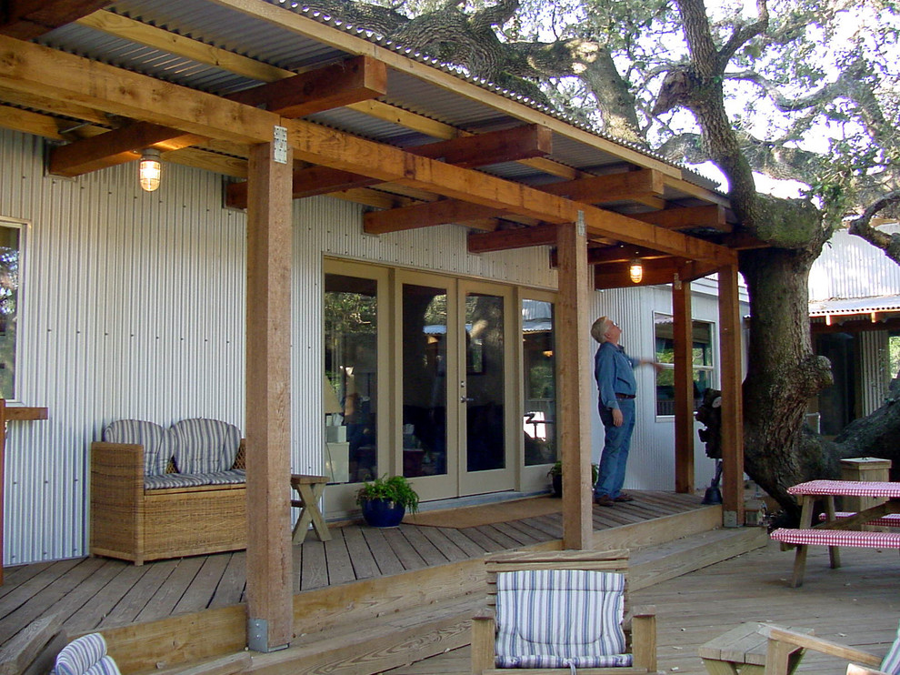 Example of an urban deck design in Austin with a pergola