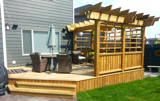 Treated Deck With Custom Privacy Screen And Pergola