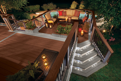 Depending on where your guests want to be, they can take one of the two sets of stairs coming off this deck. One set is diagonal and leads to the front yard, while the other leads directly down to the pool.