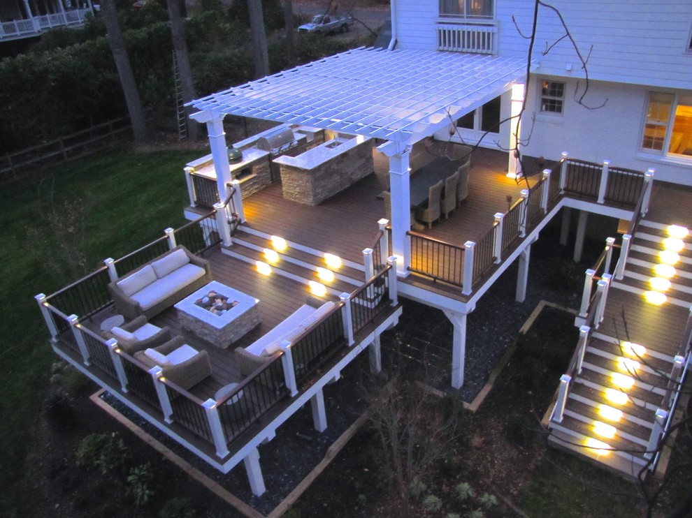 Inspiration for a large timeless backyard outdoor kitchen deck remodel in DC Metro with a pergola