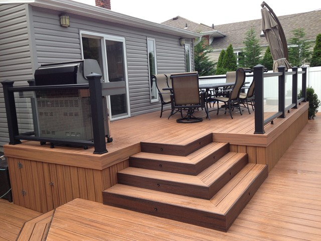 Trex transcends tropics tiki torch with trex black glass for Who makes tropics decking