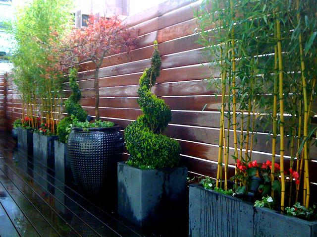 Tribeca roof garden deck bamboo fence container garden for Decking terrace garden