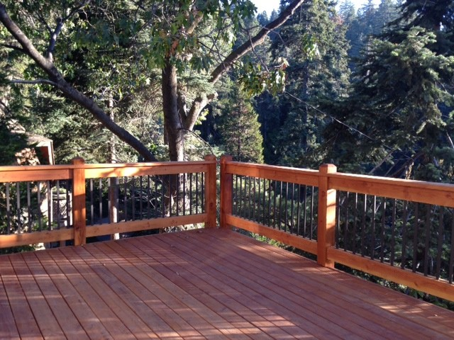 Two story wrap around deck with custom design railings for Two story deck design pictures