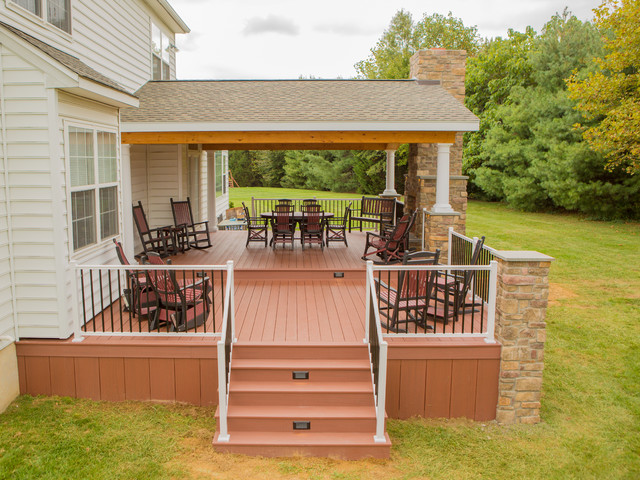 Two Tier Deck With Stone Fireplace