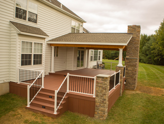 Two tier deck with stone fireplace rustic deck other for Rustic porches and decks