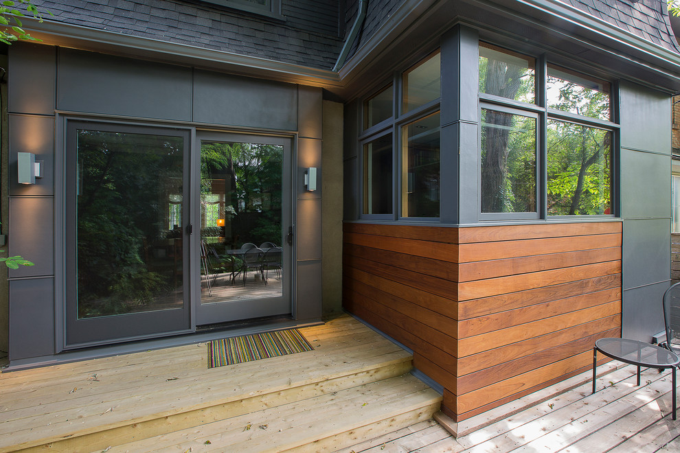 Example of a mid-sized trendy backyard deck design in Toronto