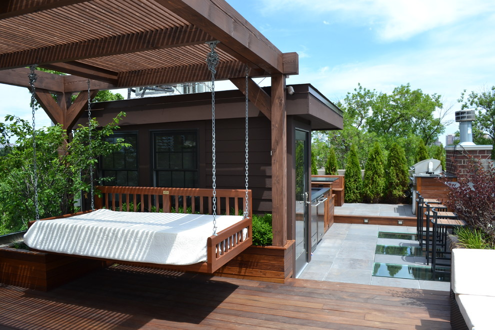Example of a large trendy rooftop outdoor kitchen deck design in Chicago with a pergola