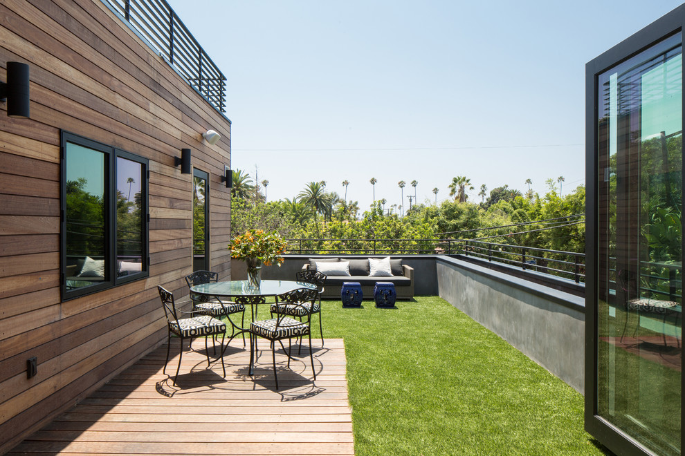 Inspiration for a small contemporary rooftop deck remodel in Los Angeles with no cover